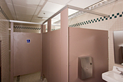 Floor-mounted toilet compartments with overhead-braced construction